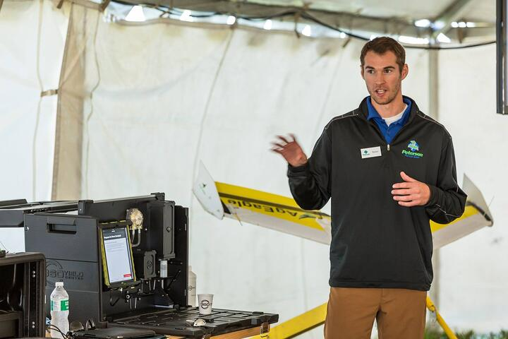 Nolan presenting to a group of growers at Peterson Farms Seed's annual Field Day