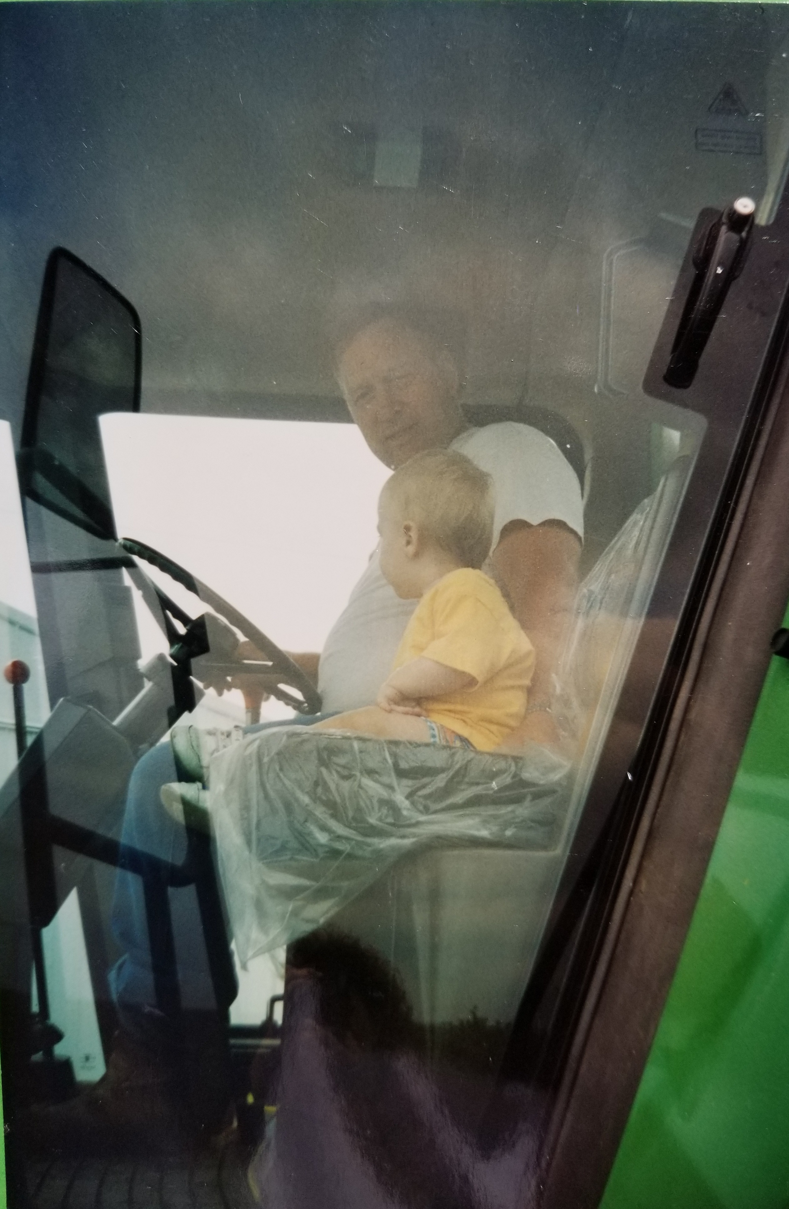 One of my early tractor rides with my grandpa
